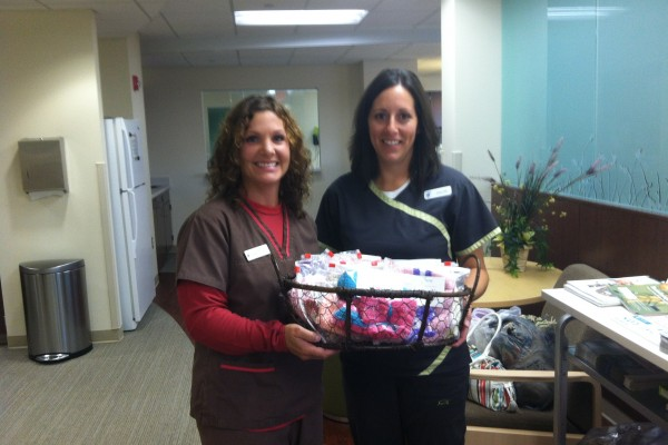 Nurses Chris & Maggie accepting our donation of chemo hats at Michiana Hematology Oncology in South Bend, IN